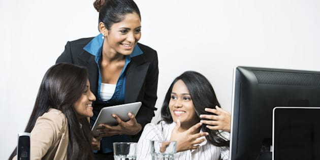 Group of happy Indian business women in a meeting at the office.