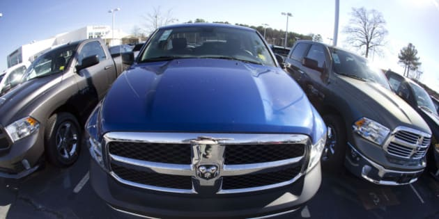 FILE - In this Jan. 5, 2015 file photo, Ram pickup trucks are on display on the lot at Landmark Dodge Chrysler Jeep RAM in Morrow, Ga. The major automakers report April sales on Friday, May 1, 2015.  (AP Photo/John Bazemore, File)