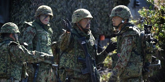 Japanese soldiers prepare during an amphibious landing operation with US Forces and the Japan Maritime Self-Defense Force (JMSDF) at the Dawn Blitz 2015 exercise in Camp Pendleton, California on September 5, 2015.  Japan's defense ministry has made its biggest ever budget request, as Tokyo bolsters its military amid lingering territorial rows and worries over China's expanding naval reach. The ministry wants 5.09 trillion yen ($42 billion) for the next fiscal year, with the focus on strengthening protection of a string of southern islands that stretch from Japan's mainland to waters near Taiwan.    AFP PHOTO / MARK RALSTON        (Photo credit should read MARK RALSTON/AFP/Getty Images)