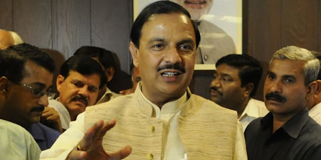 NEW DELHI, INDIA - NOVEMBER 12: BJP leader Mahesh Sharma takes charge as Minister Of State For Civil Aviation at Rajiv Gandhi Bhawan on November 12, 2014 in New Delhi, India. He also took charge as Minister Of State for Tourism and Culture. (Photo by Vipin Kumar/Hindustan Times via Getty Images)