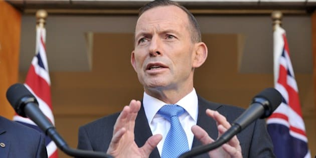 Australian Prime Minister Tony Abbott speaks to the media during a press conference at Parliament House in Canberra on September 9, 2015. Australia will take an extra 12,000 refugees in response to the humanitarian crisis in the Middle East, Abbott said, confirming Canberra would join coalition air strikes against Islamic State group in Syria. AFP PHOTO / MARK GRAHAM        (Photo credit should read MARK GRAHAM/AFP/Getty Images)