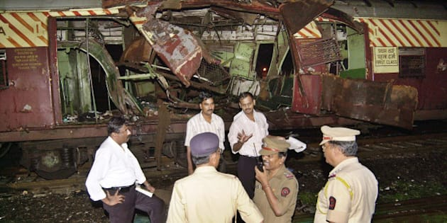Police investigate near a train destroyed by a bomb blast at Mahim railway station in Mumbai, India, in this July 11, 2006, photo in a suspected act of terrorism that killed 207 people. Asia's booming giants, China and India, confront daunting challenges as they strive to keep their economies expanding fast enough to raise growing numbers of their 2.3 billion people out of poverty. (AP Photo/Aijaz Rahi)