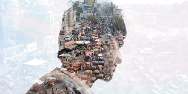 Double exposure of a man and India cityscape