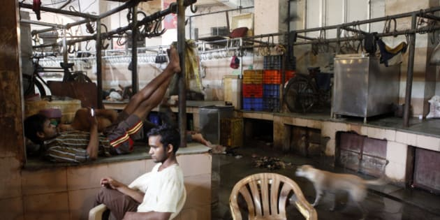 MUMBAI, INDIA - SEPTEMBER 10: Shopkeeper seen sitting idle at Crawford meat market on the first day of a four-day ban on the sale of meat on the occasion of Jain holy festival of Paryushan on September 10, 2015 in Mumbai, India. Earlier this week, the BMC imposed a ban on sale of meat on four days of the Paryushan festival, while the adjoining Mira-Bhayander Municipal Corporation in Thane had declared a complete ban during September 11-18. (Photo by Arijit Sen/Hindustan Times via Getty Images)