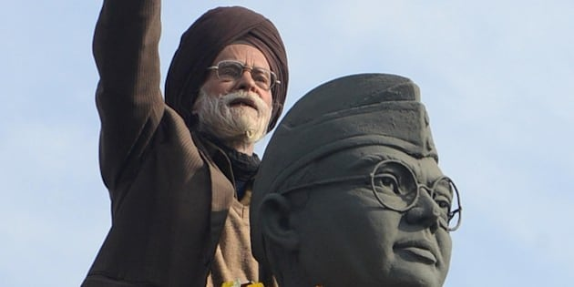 Member of the All India Azad Hind Fauj Freedom-Fighters Successors Association,Santokh Singh (C) gestures on the statue of  freedom fighter, Netaji Subhash Chandra Bose in Amritsar on January 23, 2013, as part of celebrations for his 116th birth anniversary. Bose was a prominent Indian nationalist leader who attempted to gain India's independence from British rule by force during the waning years of World War II.  AFP PHOTO/NARINDER NANU        (Photo credit should read NARINDER NANU/AFP/Getty Images)