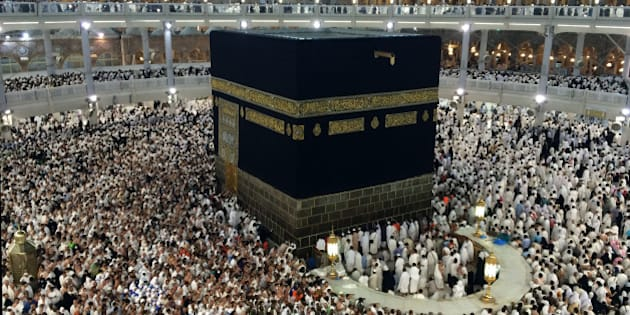 In this Saturday, Oct. 4, 2014 photo, Muslim pilgrims circle the Kaaba, the black cube at center, as they pray inside the Grand Mosque during the annual pilgrimage, known as the hajj, in the Muslim holy city of Mecca, Saudi Arabia. Muslims around the world celebrated the start of Islam's biggest holiday on Saturday as more than 2 million pilgrims took part in one of the final rites of the annual hajj pilgrimage in Saudi Arabia. (AP Photo/Khalid Mohammed)