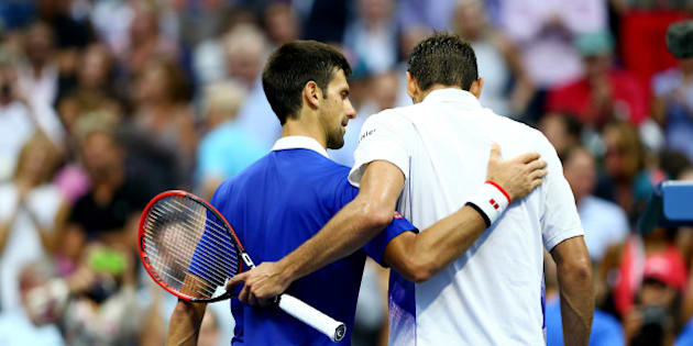 NEW YORK, NY - SEPTEMBER 11:  Novak Djokovic (L) of Serbia embraces Marin Cilic of Croatia after defeating him during their Men's Singles Semifinals match on Day Twelve of the 2015 US Open at the USTA Billie Jean King National Tennis Center on September 11, 2015 in the Flushing neighborhood of the Queens borough of New York City. Djokovic defeated Cilic   6-0, 6-1, 6-2.  (Photo by Clive Brunskill/Getty Images)