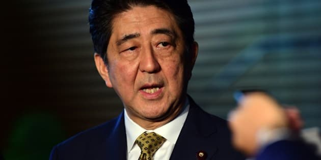Japanese Prime Minister SHinzo Abe speaks to reporters at his official residence in Tokyo on September 8, 2015. Abe extended his term as party leader, putting himself potentially on course to the longest-serving premier in Japanese politics in decades. AFP PHOTO / POOL / Yoshikazu TSUNO        (Photo credit should read YOSHIKAZU TSUNO/AFP/Getty Images)