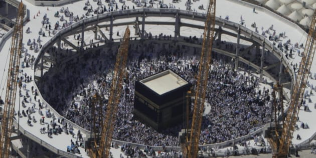 FILE - In this Wednesday, Oct. 16, 2013 file photo, cranes rise at the site of an expansion to the Grand Mosque as Muslim pilgrims circle counterclockwise around the Kaaba at the Grand Mosque in Mecca, Saudi Arabia. A towering construction crane toppled over on Friday, Sept. 11, 2015 during a violent rainstorm in the Saudi city of Mecca, Islam's holiest site, crashing into the Grand Mosque and killing dozens of people ahead of the start of the annual hajj pilgrimage later this month.(AP Photo/Amr Nabil, File)