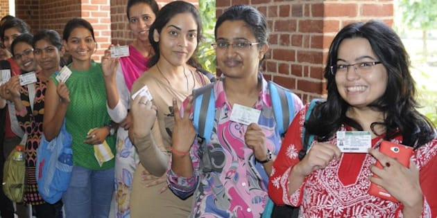 NEW DELHI, INDIA - SEPTEMBER 11: Students queue up to cast their vote for the Delhi Univesity Students Union (DUSU) Elections 2015, at Miranda House, North Campus, on September 11, 2015 in New Delhi, India. A total of 35 candidates are in the fray for the four posts of DUSU office-bearers. While nine candidates are in the race for the post of president, eight nominations have been validated for the post of vice-president. The number of students contesting for the secretary and joint secretary post is 10 and eight respectively. Students say they want a rollback of the Choice Based Credit System (CBCS) and proper hostel facilities. (Photo by Sushil Kumar/Hindustan Times via Getty Images)