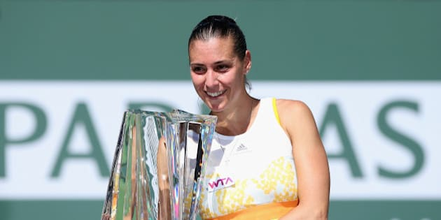 INDIAN WELLS, CA - MARCH 16:  Flavia Penneta of Italy poses with the trophy following her WTA women's final victory over Agnieszka Radwanska of Poland during the BNP Paribas Open at Indian Wells Tennis Garden on March 16, 2014 in Indian Wells, California.  (Photo by Jeff Gross/Getty Images)