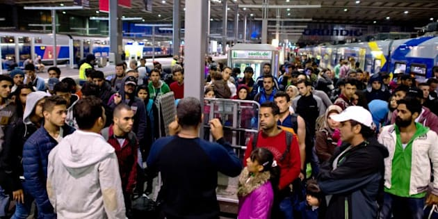 Refugees and migrants arrive  at the central station in Munich, southern Germany Sunday Sept. 13, 2015.  (Sven Hoppe/dpa via AP)