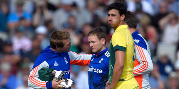MANCHESTER, ENGLAND - SEPTEMBER 13:  England batsman Eoin Morgan is looked at by the physio after being hit on the helmet by a ball from Mitchell Starc (r) and retires hurt during the 5th Royal London One-Day International match between England and Australia at Old Trafford on September 13, 2015 in Manchester, United Kingdom.  (Photo by Stu Forster/Getty Images)
