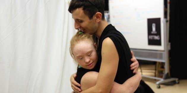 Disabled model Madeline Stuart from Brisbane, Australia hugs art director Pablo Patane during rehearsals for the FTL MODA presentation  at New York Fashion Week in New York, on September 12, 2015. AFP PHOTO/TREVOR COLLENS        (Photo credit should read TREVOR COLLENS/AFP/Getty Images)
