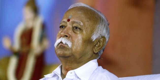 Hindu nationalist Rashtriya Swayamsevak Sangh (RSS), or the National Volunteers Force chief Mohan Bhagwat attends a meeting of their organization in Bangalore, India, Friday, March 7, 2014. The three day annual top level meeting of RSS, the parent organization of India's main political opposition Bharatiya Janta Party (BJP) started Friday. (AP Photo/Aijaz Rahi)