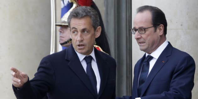 French President Francois Hollande, right, and former French President Nicolas Sarkozy speak on the steps of the Elysee Palace, Paris, Sunday, Jan. 11, 2015. A rally of defiance and sorrow, protected by an unparalleled level of security, on Sunday will honor the 17 victims of three days of bloodshed in Paris that left France on alert for more violence. (AP Photo/Thibault Camus)