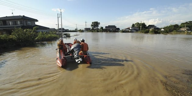 JOSO, JAPAN - SEPTEMBER 11 : Firefighters and Japan Self-Defense Force conduct search and rescue operations in Joso city, Ibatraki region after flooding in the northern of Japan on September 11, 2015. Flooding in the northern of Japan forced the evacuation of thousands of people and left large parts of one town submerged in Japan on September 11, 2015. Many parts of central and eastern Japan have been hit in recent days by torrential rain and heavy winds caused by Typhoon Etau. (Photo by David Mareuil/Anadolu Agency/Getty Images)