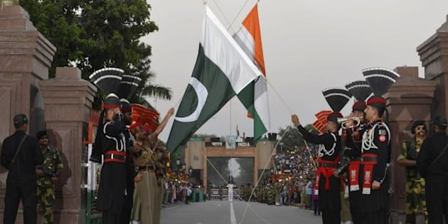 Pakistani Rangers (in black) and Indian Border Security Force (BSF) personnel perform the flag off ceremony at the Pakistan-India Wagah Border on September 12, 2015. Pakistan and India have fought two of their three wars over the Himalayan region since both gained independence in 1947, and it remains a major source of tension. AFP PHOTO / ARIF ALI        (Photo credit should read Arif Ali/AFP/Getty Images)