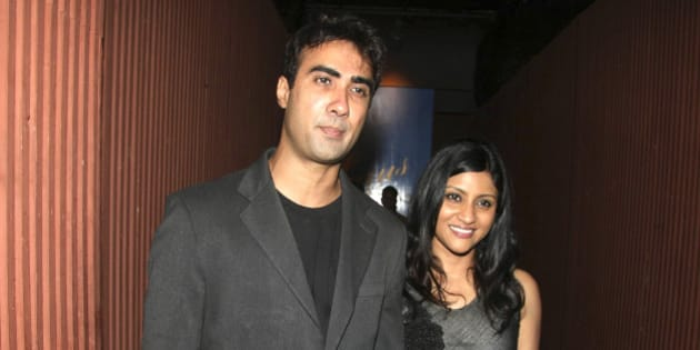 Indian Bollywood actors Ranvir Shorey (L) and his wife Konkona Sen Sharma (R) attend a Chivas promotional event in Mumbai on June 13, 2010. AFP PHOTO/STR (Photo credit should read AFP/AFP/Getty Images)