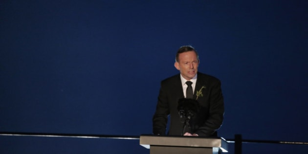 Australia's Prime Minister Tony Abbot talks during the Dawn Service ceremony at the Anzac Cove beach in Gallipoli peninsula, Turkey, early Saturday, April 25, 2015. Anzac Cove is a small cove on the Gallipoli peninsula and the site of World War I landing of the ANZACs (Australian and New Zealand Army Corps) on April, 25, 1915. World leaders gathered with the descendants of the fighters in Gallipoli, the memories of one of the most harrowing campaigns of the 20th century have come surging back to life. The doomed Allied offensive to secure a naval route from the Mediterranean to Istanbul through the Dardanelles, and take the Ottomans out of the war, resulted in over 130,000 deaths on both sides. (AP Photo/Lefteris Pitarakis)