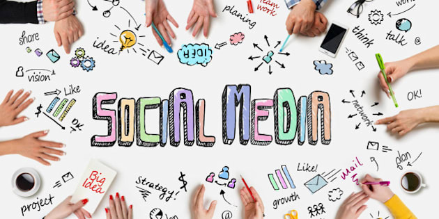 Business people group works at a table - Social Media Concept