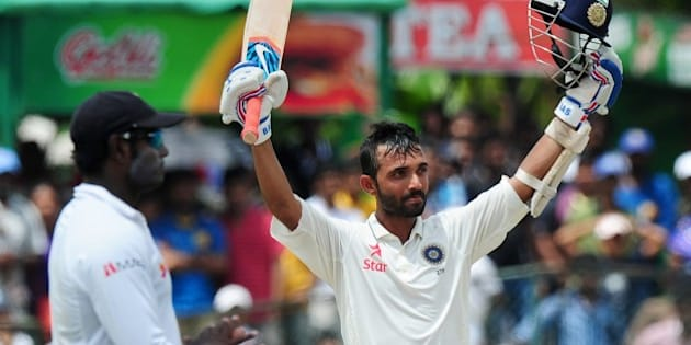 Indian cricketer Ajinkya Rahane raises his bat and helmet in celebration after scoring a century (100 runs) during the fourth day of the second Test match between Sri Lanka and India at the P. Sara Oval Cricket Stadium in Colombo on August 23, 2015.  AFP PHOTO / LAKRUWAN WANNIARACHCHI        (Photo credit should read LAKRUWAN WANNIARACHCHI/AFP/Getty Images)