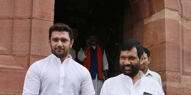 NEW DELHI, INDIA - AUGUST 5: Lok Janshakti Party supremo Ram Vilas Paswan with son Chirag Paswan at Parliament House, on August 5, 2015 in New Delhi, India. Congress and some opposition parties on Wednesday persisted with their protest against the suspension of 25 MPs as the stalemate in the Rajya Sabha continued over the opposition demand for the resignations of three BJP leaders. (Photo by Sanjeev Verma/Hindustan Times via Getty Images )