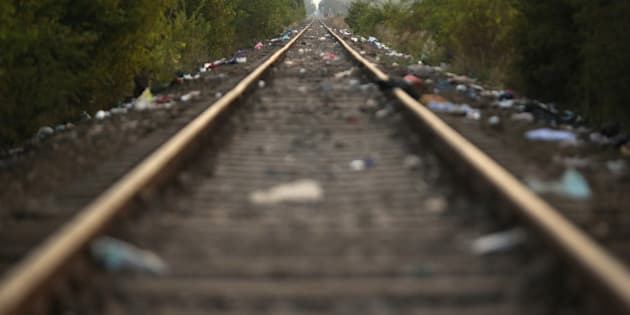 ROSZKE, HUNGARY - SEPTEMBER 15: The infamous rail track into Hungary that thousands of migrants used to cross the Serbian-Hungarian border near the village of Roszke is now compltetely deserted after it was closed by the authorities on September 15, 2015 in Roszke, Hungary. Hungary has introduced tough new laws to administer the influx of migrants which became enforceable today. The infamous rail track crossing which saw thousands of migrants cross the border from Serbia into Hungary has now been closed and blocked with a rail cargo truck and razor wire. Migrants are now directed to a controlled crossing point 2km west. Since the beginning of 2015 the number of migrants using the so-called 'Balkans route' has exploded with migrants arriving in Greece from Turkey and then travelling on through Macedonia and Serbia before entering the EU via Hungary. The number of people leaving their homes in war torn countries such as Syria, marks the largest migration of people since World War II.  (Photo by Christopher Furlong/Getty Images)