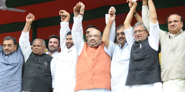 PATNA, INDIA - JULY 16: BJP Chief Amit Shah with LJP Chief Ram Vilas Paswan, HAM Chief Jitan Ram Manjhi, BJP leader Sushil Kumar Modi and other NDA leaders flagging off the 'Parivartan Rath at Gandhi Maidan on July 16, 2015 in Patna, India. These chariots will travel to all the villages spread covering 243 assembly seats of Bihar ahead of July 25 rally of Prime Minister Narendra Modi in Muzaffarpur. The party plans to hold 100,000 meetings in 100 days ahead of the elections. (Photo by AP Dube/Hindustan Times via Getty Images)