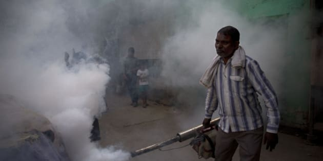 A municipal worker fumigates a residential area to prevent mosquitoes from breeding in New Delhi, India, Monday, Sept. 7, 2015. With several cases of Dengue fever, a mosquito-borne disease, being reported across the capital, the civic authorities are taking precautions to contain the disease. (AP Photo/Tsering Topgyal)