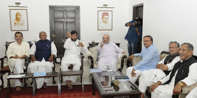NEW DELHI, INDIA - AUGUST 31: BJP President Amit Shah, LJP Chief Ram Vilas Paswan, HAM(S) Supremo Jitan Ram Manjhi, RLSP President Upendra Kushwaha and other NDA leaders at a meeting to discuss the strategy for the upcoming Bihar assembly polls on August 31, 2015 in New Delhi, India. BJP led NDA is yet to announce on its seat sharing formula. The JD-U, RJD and Congress alliance has already announced its seat sharing arrangement for the 243-member Bihar assembly. (Photo by Sushil Kumar/Hindustan Times via Getty Images)