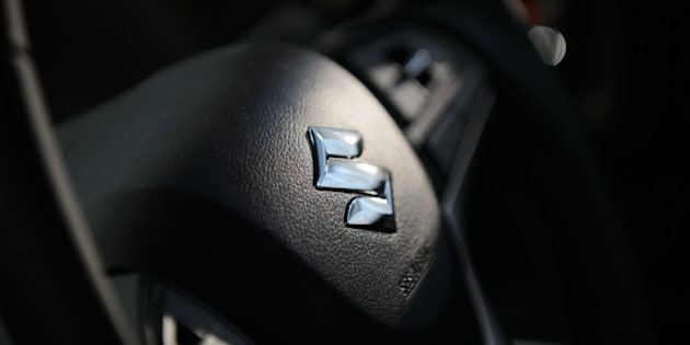 The Suzuki Motor Corp. logo sits on the steering wheel of the company's new Solio Bandit vehicle during the unveiling in Tokyo, Japan, on Wednesday, Aug. 26, 2015. Toshihiro Suzuki, 56, became president on June 30, concentrating on executing strategy set by the board, which will be headed by Osamu Suzuki, 85, who stays on as chairman and chief executive officer. Photographer: Akio Kon/Bloomberg via Getty Images
