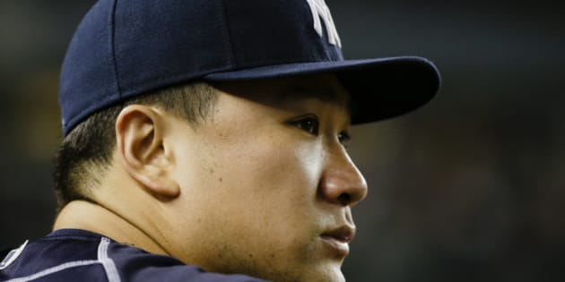 New York Yankees starting pitcher Masahiro Tanaka, of Japan, watches his team play during the ninth inning of a baseball game against the Cleveland Indians Thursday, Aug. 20, 2015, in New York. The Indians won 3-2. (AP Photo/Frank Franklin II)