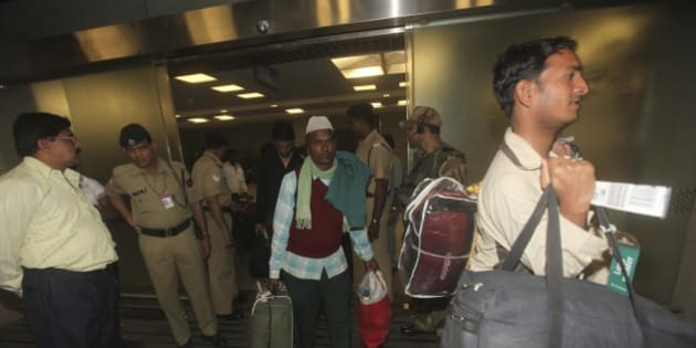 Indian laborers who were evacuated from Libya because of the ongoing conflict,  arrive at the International airport, in Mumbai, India, Friday, March 4, 2011, as they return home.(AP Photo/Rafiq Maqbool)