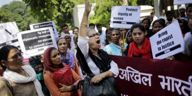 Activists of All India Democratic Women's Association shout slogans during a protest outside the Saudi Arabian embassy in New Delhi, India, Thursday, Sept. 10, 2015. Two Nepalese maids who alleged they were beaten and raped by a Saudi diplomat in India have been taken to a women's shelter in Nepal. (AP Photo/Altaf Qadri)