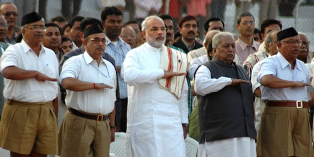 Gujarat state chief minister Narendra Modi, third left, former chief minister Keshubhai Patel, second right, and leaders of Hindu nationalist Rashtriya Swayamsevak Sangh (RSS), in front, salute during the concluding ceremony of the eight-day RSS convention in Ahmadabad, India, Sunday, Jan. 1, 2006. (AP Photo/Ajit Solanki)