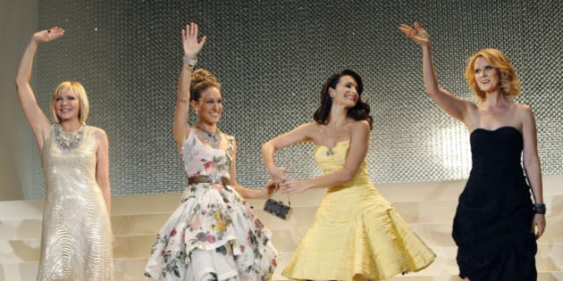 """U.S. actresses, from left, Kim Cattrall, Sarah Jessica Parker, Kristin Davis and Cynthia Nixon, wave upon arrival for the Japan Premiere of the film """"Sex and the City 2"""" in Tokyo Tuesday, June 1, 2010. (AP Photo/Shizuo Kambayashi)"""