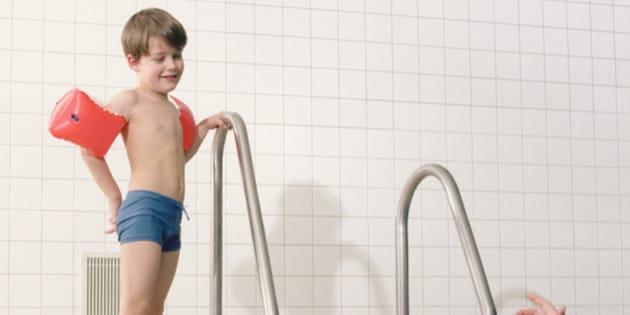 Mother encouraging Son in Swim-wings