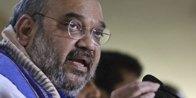 India's ruling Bharatiya Janata Party (BJP) President Amit Shah speaks at a press conference in Hyderabad, India, Thursday, Jan. 8, 2015. Shah is on a two-day visit to the newly created state Telangana. (AP Photo/Mahesh Kumar A.)