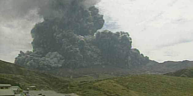 In this image taken from a surveillance camera observed from Kusasenri and released by Japan Meteorological Agency, a column of black smoke rises from Mount Aso, Kumamoto prefecture, southern Japan Monday, Sept. 14, 2015. Mount Aso, a volcano on the southern Japanese island of Kyushu, has erupted, sending huge plumes of black and then white smoke 2,000 meters (6,560 feet) into the air. (Japan Meteorological Agency via AP) CREDIT MANDATORY