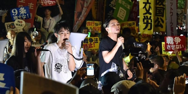 Members of SEALDs (Students Emergency Action for Liberal Democracy - s) stage a rally against Japanese Prime Minister Shinzo Abe's controversial security bills in front of the National Diet in Tokyo on September 18, 2015.  Japan was expected to pass security bills on September 18 that would allow troops to fight on foreign soil for the first time since World War II, despite fierce criticism it will fundamentally alter the character of the pacifist nation.   AFP PHOTO / KAZUHIRO NOGI        (Photo credit should read KAZUHIRO NOGI/AFP/Getty Images)