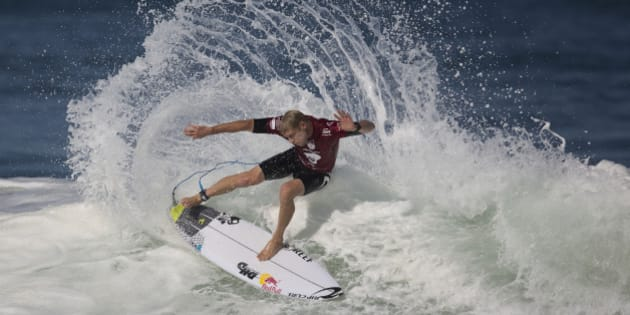 Hawaiian surfer Mick Fanning competes in the 2015 Oi Rio Pro World Surf League competition at Barra da Tijuca beach in Rio de Janeiro, Brazil, Tuesday, May 12, 2015. (AP Photo/Leo Correa)