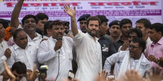 Congress party Vice President Rahul Gandhi waves as he leaves after addressing a protest by sanitation workers in New Delhi, India, Wednesday, June 17, 2015. Hundreds of sanitation workers gathered near the Indian parliament for a protest demanding the payment of wages due to them. (AP Photo/Tsering Topgyal)
