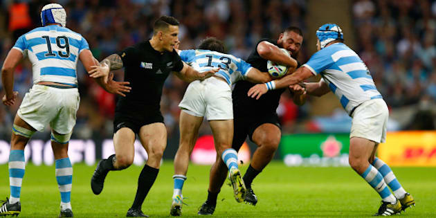 LONDON, ENGLAND - SEPTEMBER 20:  Charlie Faumuina of the New Zealand All Blacksis tackled by Marcelo Bosch of Argentina and Lucas Noguera of Argentina  during the 2015 Rugby World Cup Pool C match between New Zealand and Argentina at Wembley Stadium on September 20, 2015 in London, United Kingdom.  (Photo by Phil Walter/Getty Images)