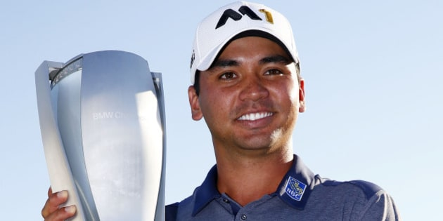 LAKE FOREST, IL - SEPTEMBER 20:  Jason Day of Australia celebrates with the winner's trophy after the Final Round of the BMW Championship at Conway Farms Golf Club on September 20, 2015 in Lake Forest, Illinois.  (Photo by Jamie Squire/Getty Images)