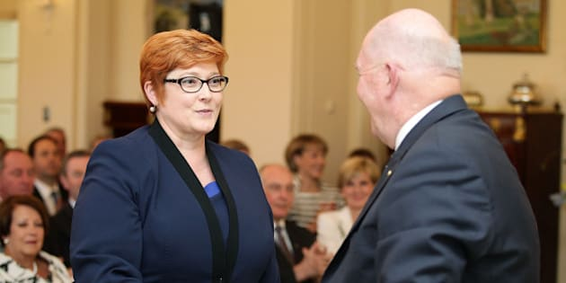 CANBERRA, AUSTRALIA - SEPTEMBER 21:   Minister for Defence Marise Payne is congratulated by Governor-General Sir Peter Cosgrove during the swearing-in ceremony of the new Turnbull Government at Government House on September 21, 2015 in Canberra, Australia. Prime Minister Malcolm Turnbull announced a new look front bench on Sunday.  (Photo by Stefan Postles/Getty Images)