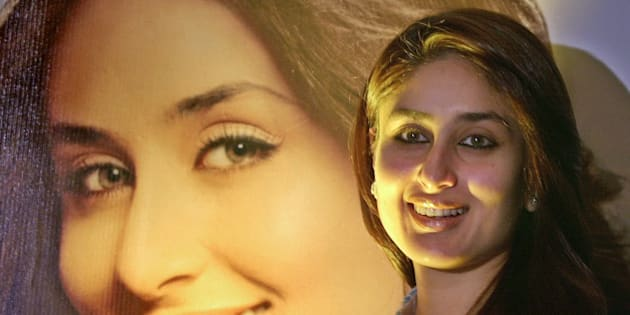 Bollywood actress Kareena Kapoor poses for the media during a promotional for Garnier in Bombay, India, Wednesday, Oct. 26, 2005. Garnier signed Kapoor as their brand ambassador. In the background is Kapoors poster. (AP Photo/Aijaz Rahi)