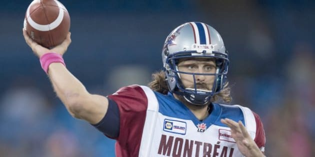 Montreal Alouettes quarterback Jonathan Crompton launches a pass against the Toronto Argonauts during the first half CFL game in Toronto on Saturday, Oct. 18, 2014. (AP Photo/The Canadian Press, Frank Gunn)