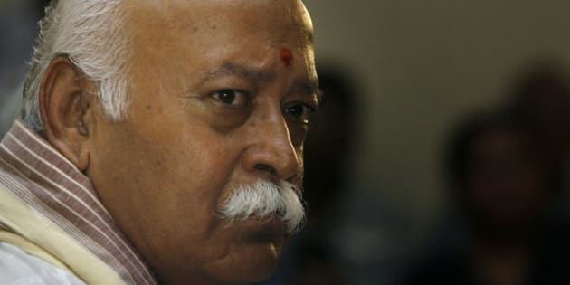 Mohan Bhagwat, chief of the Rashtriya Swayamsevak Sangh (RSS), or the National Volunteers Force, gestures during a press conference in New Delhi, India, Friday, Aug. 28, 2009. Bhagwat said that the RSS would not interfere in the internal party work of the Hindu nationalist Bharatiya Janata Party (BJP), with reference to the recent turmoil within the BJP. The RSS is the parent organization of the BJP. (AP Photo/Manish Swarup)