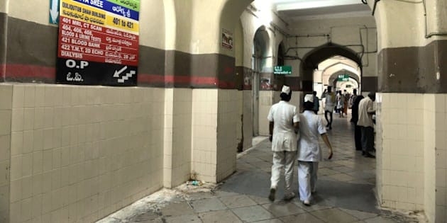 In this photograph taken on July 29, 2015, Indian nurses walk in a corridor at Osmania General Hospital (OGH) in Hyderabad. The hospital, which was completed in 1919 was designed by British architect Vincent Esch for Mir Osman Ali Khan and is an example of the blending of Indian and European architecture popular in the early twentieth century now faces demolition by the Telangana government which has prompted debate on social media among many including Bollywood personalities and international authors.     AFP PHOTO/NOAH SEELAM        (Photo credit should read NOAH SEELAM/AFP/Getty Images)